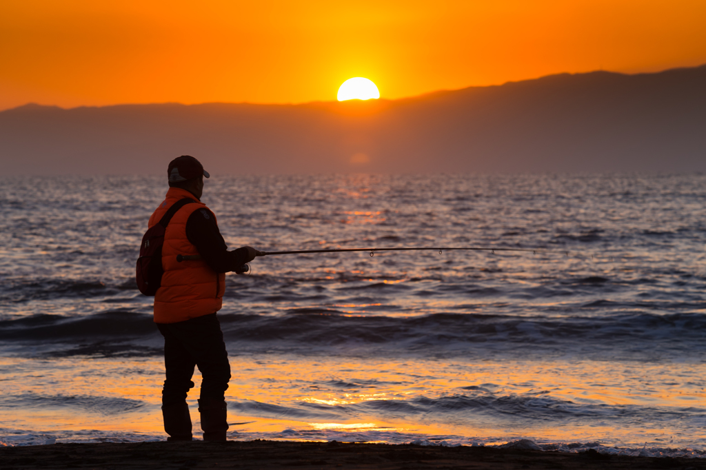 日没の釣り人